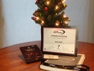 Image of certification, textbook, DVD, name badge